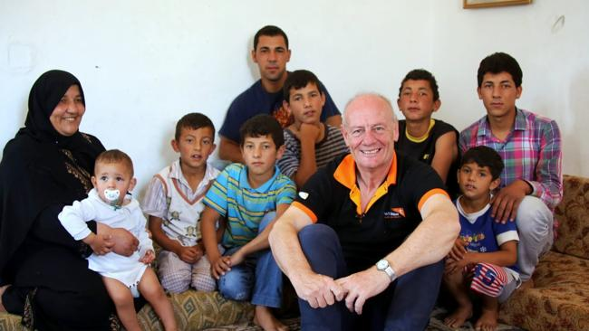 Ibtisam, mother of 12, (left) with members of her family and World Vision chief executive Tim Costello..