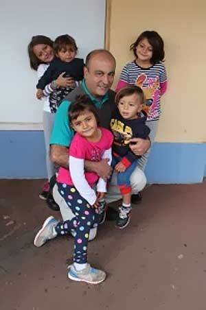 Gerry Georgatos, the writer of this article, with five of the seven children who are in need of a secure home