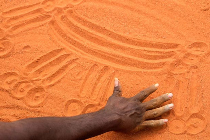 Sand drawing as a language