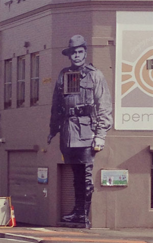 Street artist Hego's artwork #blackanzac up on the wall at the Aboriginal Housing Company on the Block in Redfern.