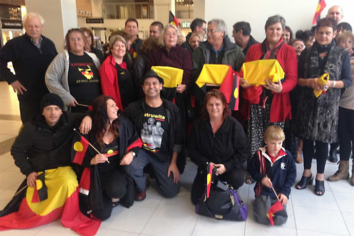 Supporters at Launceston airport welcome the return of Aboriginal remains repatriated from Chicago