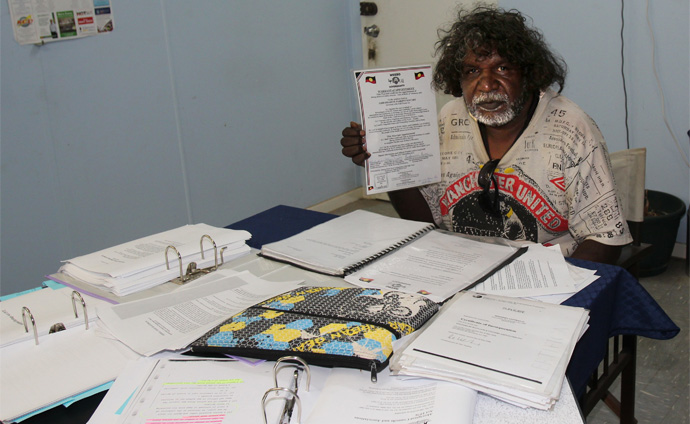 Dadawarra with some of the paperwork that he has amassed in the pursuit of proving his claim to sovereignty<