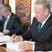 Colin Barnett, the WA Premier reduced the sacred sites registered in his state by 1,300