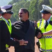 Fred Hooper being apprehended by Australina Federal Police officers