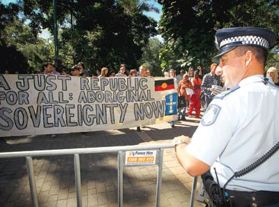 A police officer stands outside Queensland Parliament during a protest by members of the Brisbane Aboriginal Sovereign Embassy last month. (AAP IMAGE/PATRICK HAMILTON)