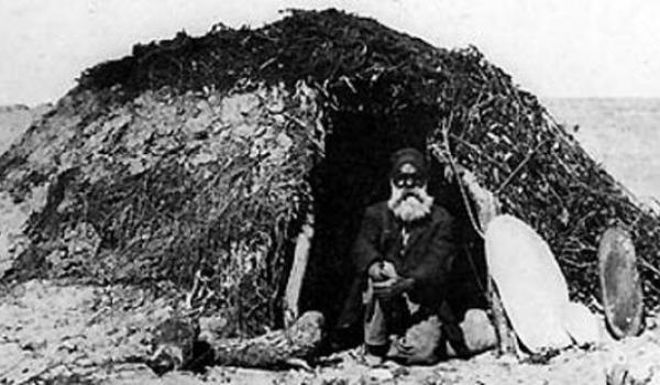 A picture in Dr Memmot's book shows an Aboriginal man sitting in the doorway of a dome-shaped building