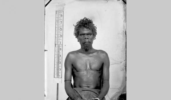 Paul Foelsche, Studio portrait if Aboriginal man, hand chained at right c.1875, Northern Territory