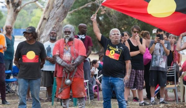 Protesters stand their ground as police move on island camp. Picture: Mogens Johansen 'The West Australian'