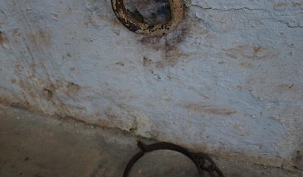 Chain ring in Roebourne gaol. The band on the floor goes around the prisoner's neck.