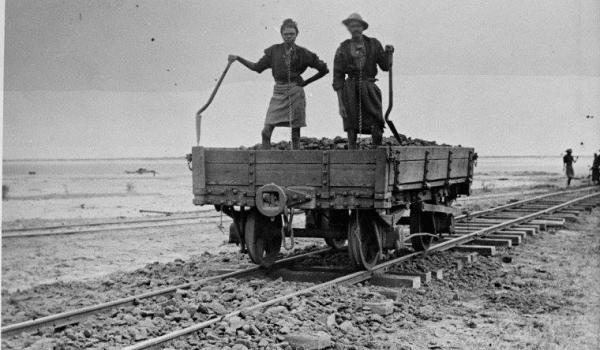 Aboriginals in chains, jetty railway ballast laying in Derby, West Kimberley WA, ca. 1897