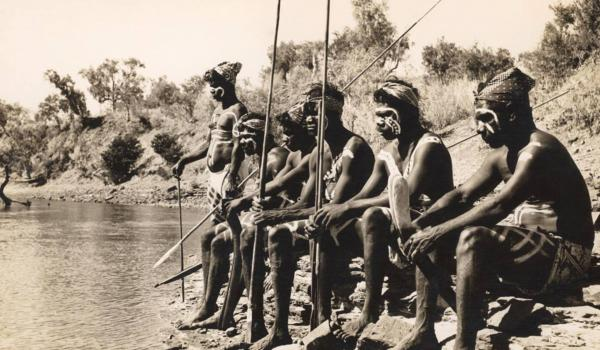 en watch for crocodiles while waiting for a ceremony at Victoria River, NT, in 1952. Arthur Groom / IDIDJ Australia