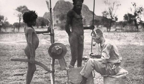 Reverend Kingsley Partridge, seated, using a Portable Pedal Radio at Haasts Bluff (known today as Ikuntji), Northern Territory, 1934
