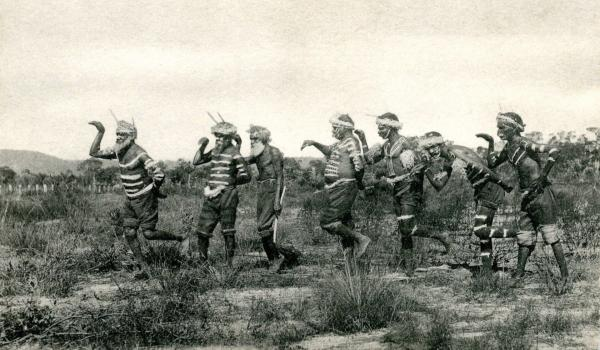 Noongar men performing an emu dance near Perth, Western Australia, in 1905. Third from left without body paint is Joobaitch, fourth from left is Monnop. Other individuals likely to include Woolber, Genbursong and Dool