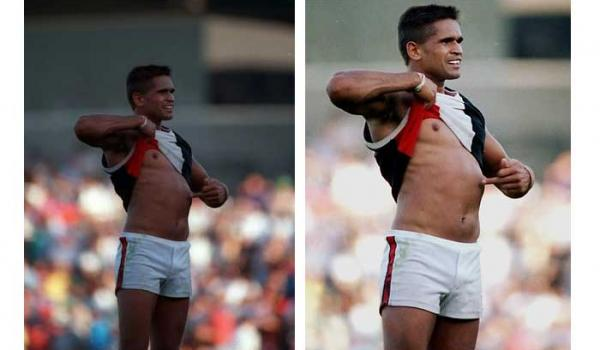 Nicky Winmar AFL Football player shows the colour of his skin to the crowd after another harrowing day of onfield racism