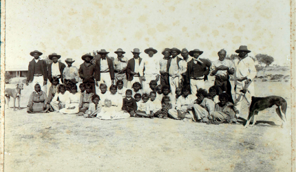 'Natives' at a Pilbara station, Corunna Downs, 1905. Some of the children were fathered by white men, who were often set away to work as domestics or farm labourers in other location.