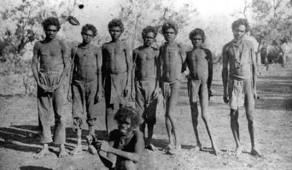 Aboriginal men in chains on Ord River Station, 1900s. (Battye 004648d)