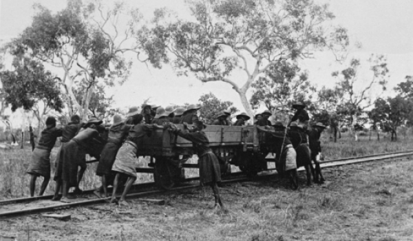 Aboriginal prisoners in chains in a railway wagon, Derby, 1897 (State Library WA)