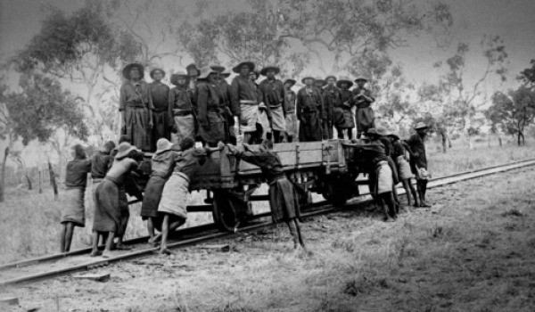 Aboriginal prisoners in chains in a railway wagon, Derby, 1897