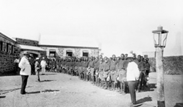 "Roebourne Prison pictured. In 1889, Samuel McLeod wrote, ""On arriving at Roebourne we saw gangs of unfortunate Aborigines chained to wheelbarrows with bullock chains… The effect of the chains can be imagined in a climate where the stones get so hot they cannot be handled. The sight was too painful for most of us from a free land."" (Photo – Battye Library, WA)"