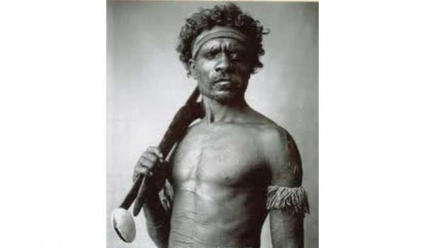 Believed to be an unidentified NQ warrior captured by Henry King c1900 - He holds a shell tipped spear-thrower of the Cape Grenville type, and a boomerang, with the band representing his clan - This image is often reputed to be Pemulwuy NSW Warrior