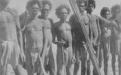 1901. Prisoners captured by police at 2/​6 per head. Line of Aboriginal men chained together at the neck. (State Library of WA)