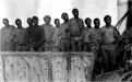 Aboriginal prisoners in neck chains aboard the vessel RMS N2, probably being transported to Wajemup (Rottnest Island). (State Library of Western Australia)