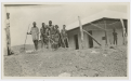 Six Aboriginal men in chains with tools in front of a Halls Creek Hospital  (Photo: M.E. McCombe 'nursing days')